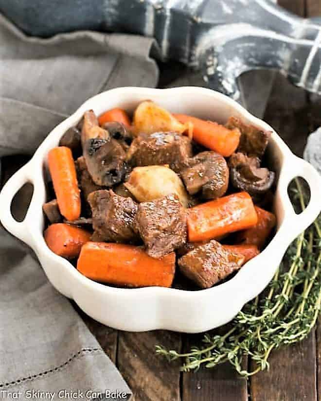 Slow cooker beef stew with mushrooms in a casserole dish