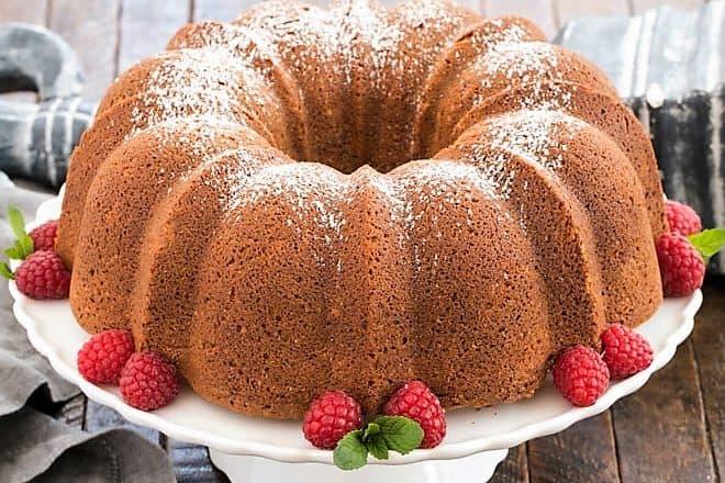 white chocolate pound cake on a white ceramic cake plate