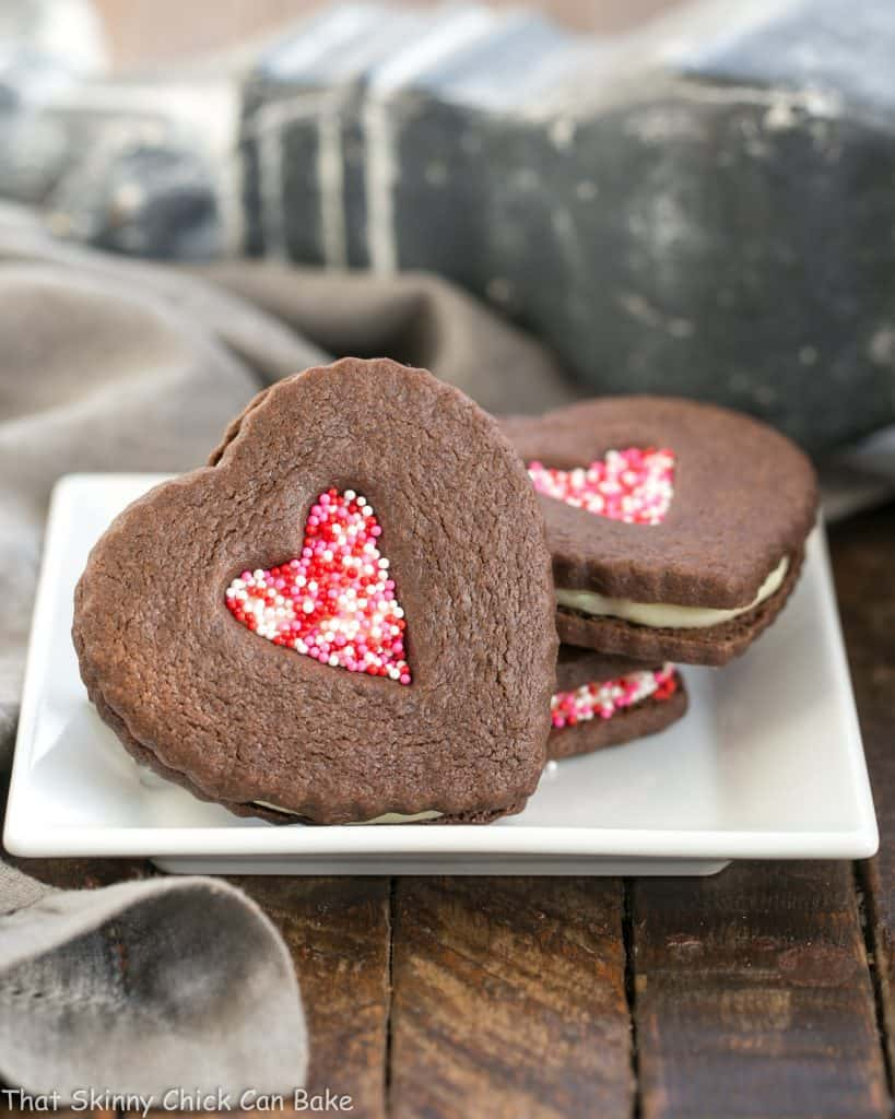 Chocolate Heart Sandwich Cookies on a square white plate