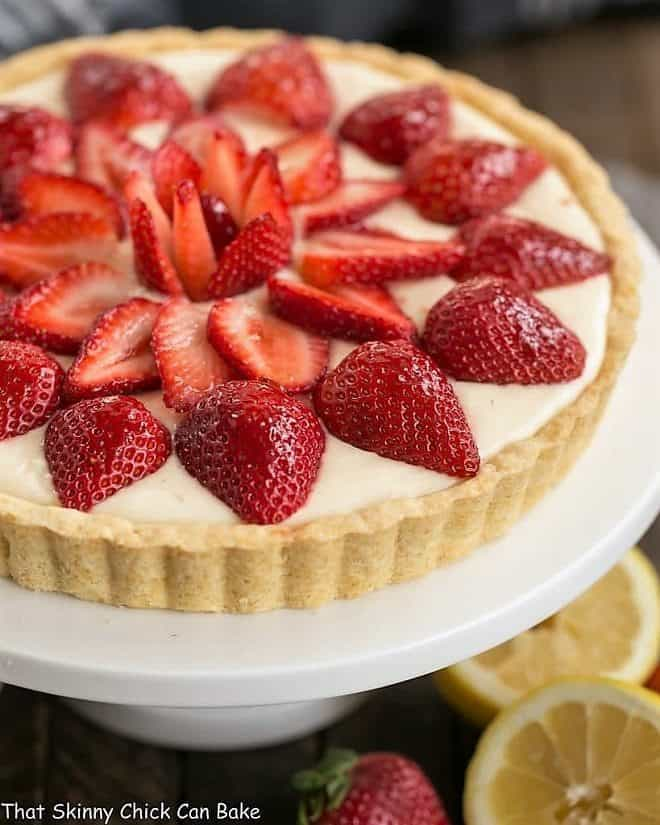 Strawberry Lemon Tart on a white cake stand