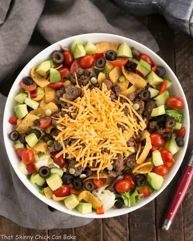 Overhead view of Beef Taco Salad with Salsa Dressing in a white serving bowl