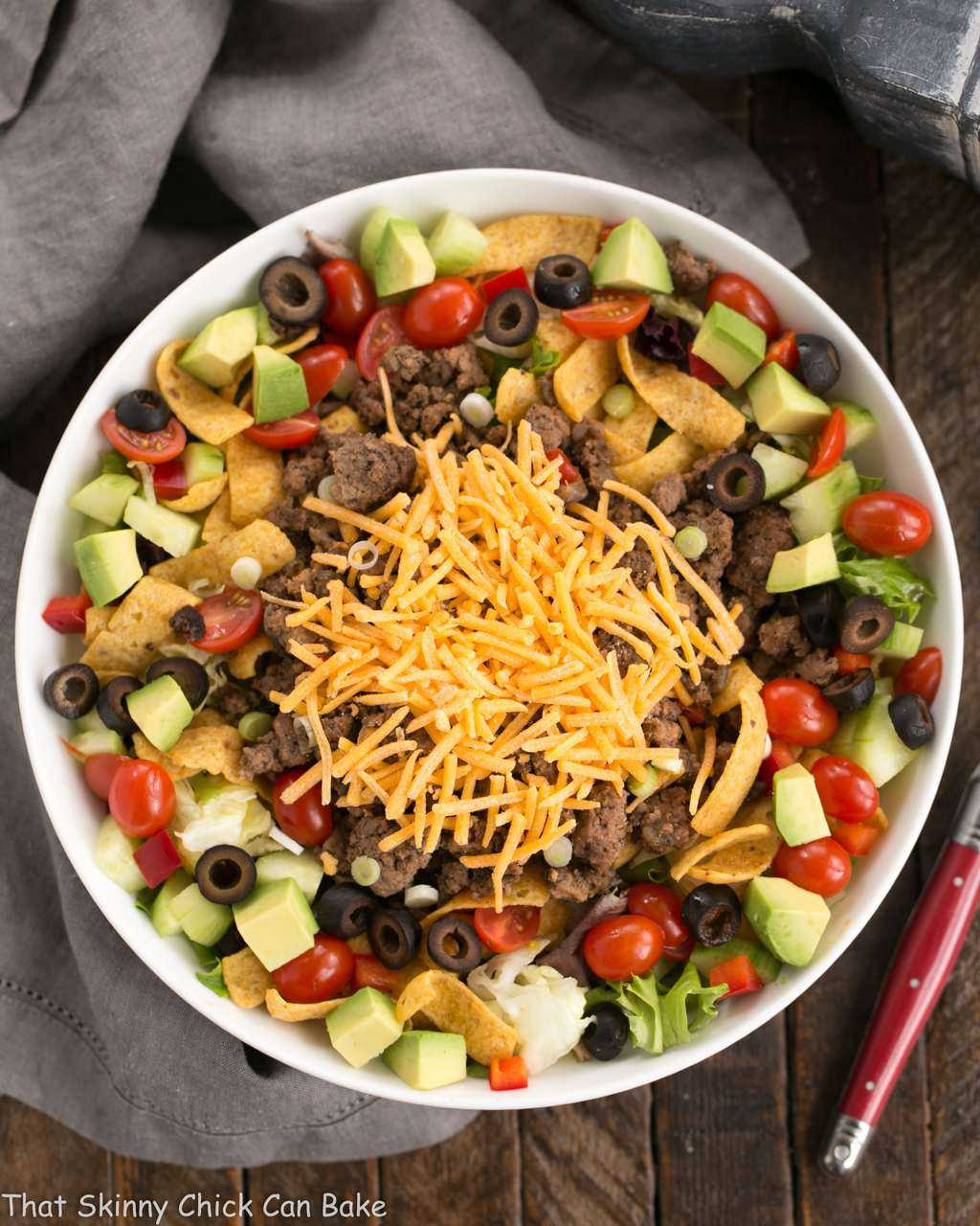 Beef Taco Salad with Salsa Dressing - a Tex-Mex salad with spicy ground beef, veggies, cheese and a creamy salsa dressing