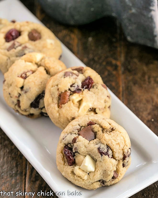 Chewy Cherry Chocolate Chunk Cookies on a narrow white tray