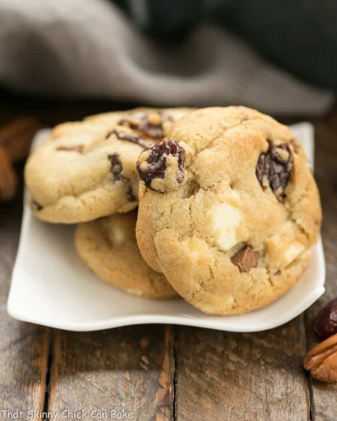 Chewy Cherry Chocolate Chunk Cookies on a wavy square plate