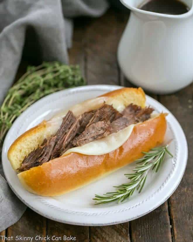 Instant Pot French Dip Sandwiches on a plate with au jus