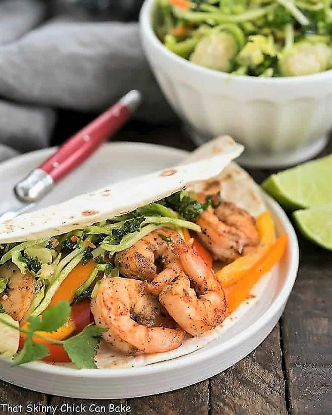 Easy Seafood Fajitas on a white plate with a red handled fork