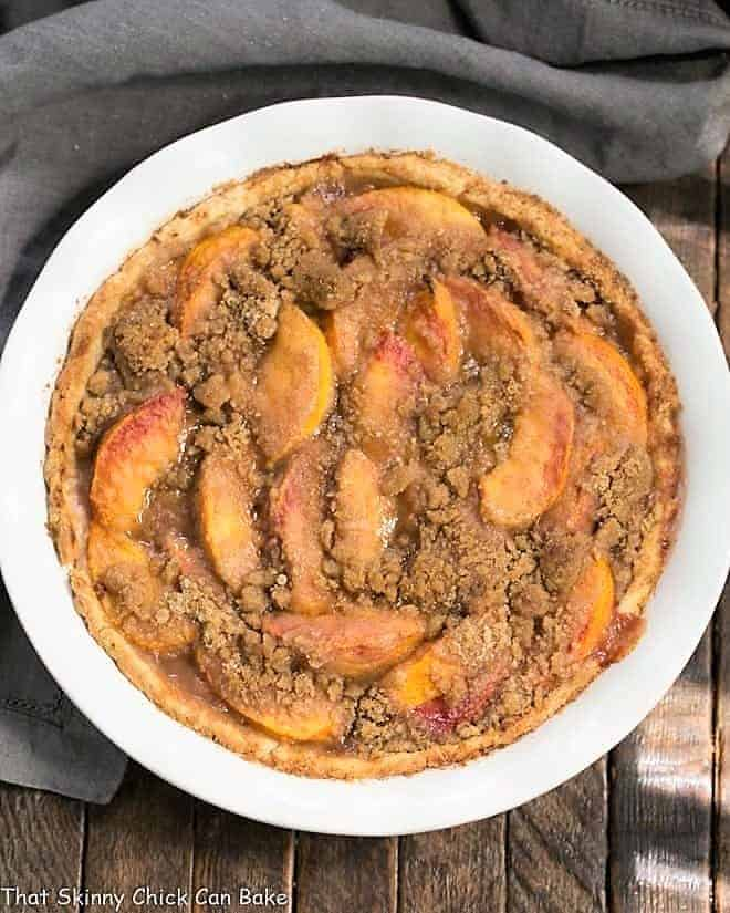 Overhead view of an Easy Peach Crumb Pie in a white pie plate