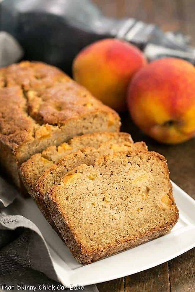 Fresh Southern Peach Soda Bread sliced on a white rectangular tray