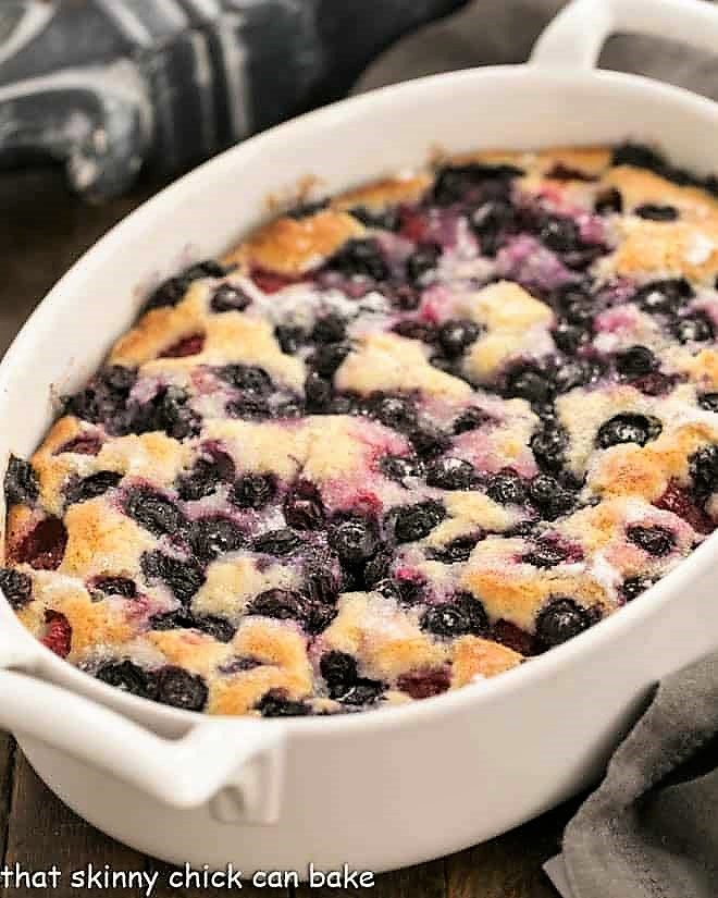 Mixed berry cobbler in a white, oval casserole