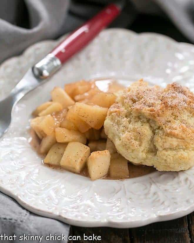 Apple Cobbler on a white plate with a red handled fork