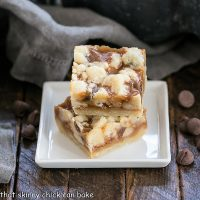 Two Chocolate Chip Caramel Butter Bars on a square white dish
