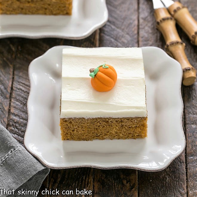 Pumpkin bar on a square wite plate with a couple bamboo forks