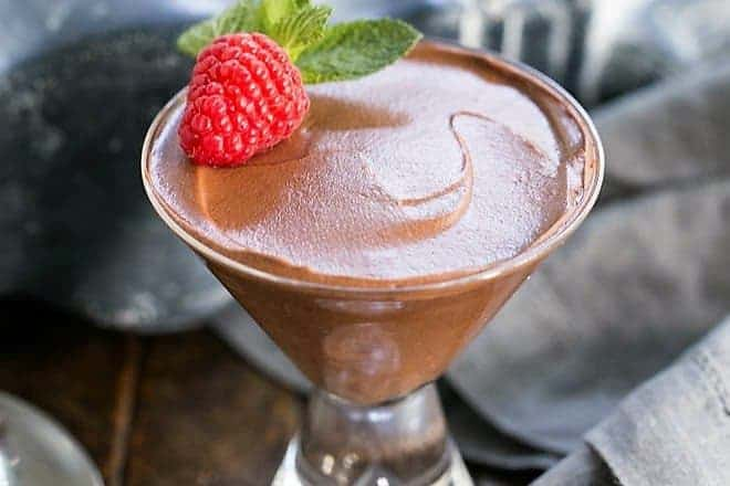 Chocolate Truffle Mousse AKA Mousse au Chocolat in a martini glass with a raspberry and mint
