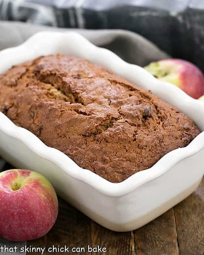 Sliced Glazed Cranberry Apple Bread in a white loaf pan