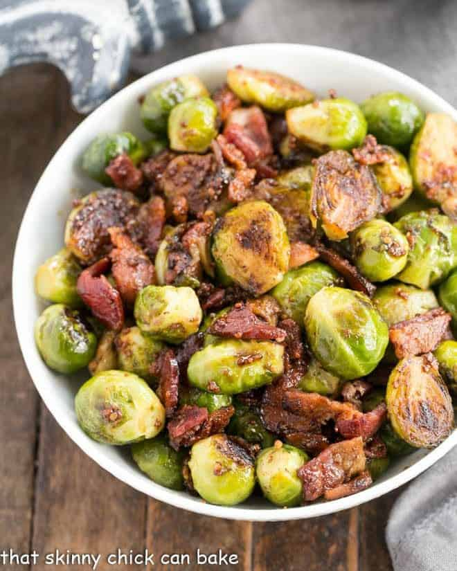 Maple Syrup Mustard Glazed Brussels Sprouts in a white serving bowl