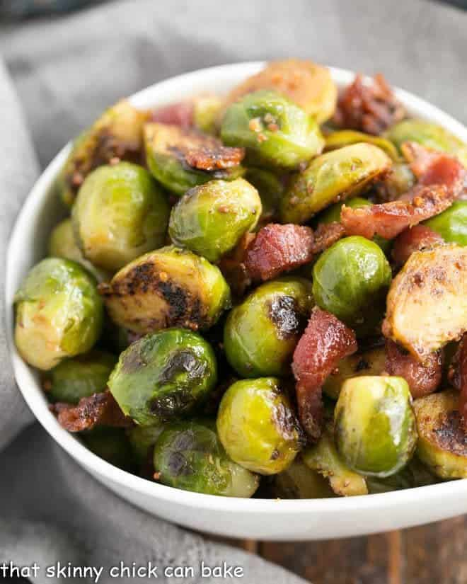 Maple Syrup Mustard Glazed Brussels Sprouts closeup in a white ceramic bowl