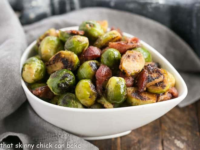 Maple Syrup Mustard Glazed Brussels Sprouts in a tear shaped bowl