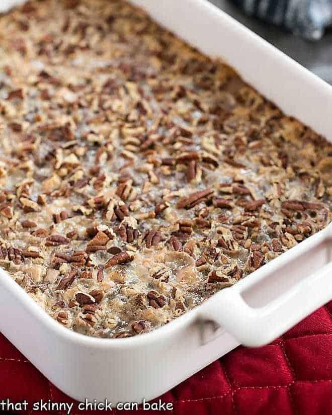 Toffee Caramel Magic Cookie Bars in a ceramic baking dish