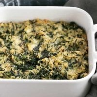 Cheesy Spinach Rice Casserole baked in a square casserole dish