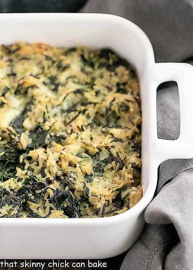 Cheesy Spinach Rice Casserole baked in a white baking dish