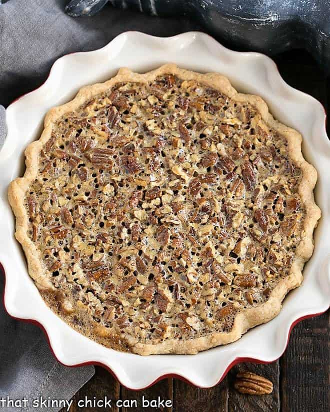 Classic Pecan Pie in a red pie plate overhead view