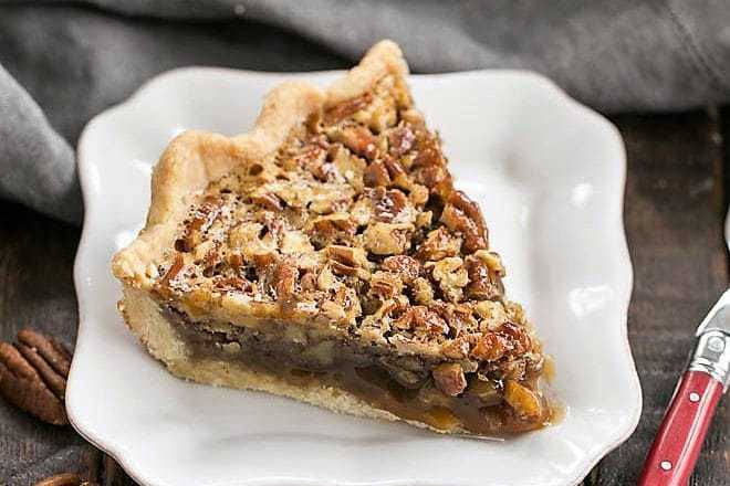 Classic Pecan Pie slice with a red handled fork