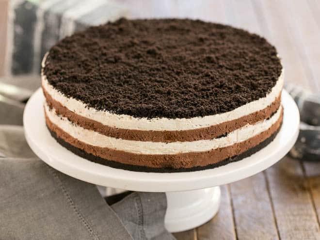 Layered Chocolate Cream Torte on a white cake plate