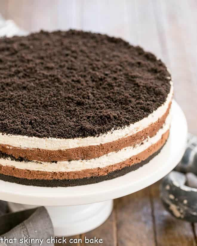 Layered Chocolate Cream Torte on a white ceramic cake plate