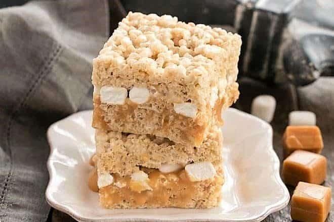 2 Caramel Stuffed Rice Krispie Treats on a square white plate
