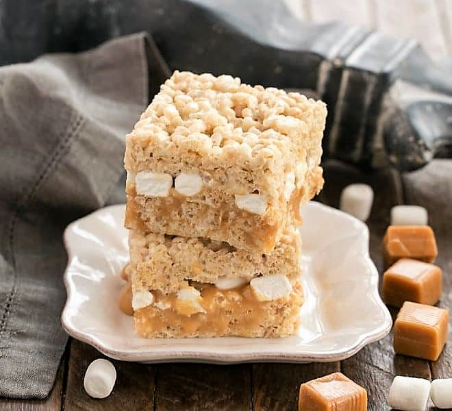 2 Caramel Stuffed Rice Krispie Treats on a square white plate