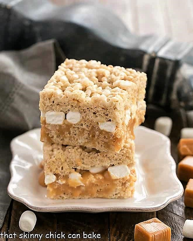 Caramel Stuffed Rice Krispie Treats on a square white plate