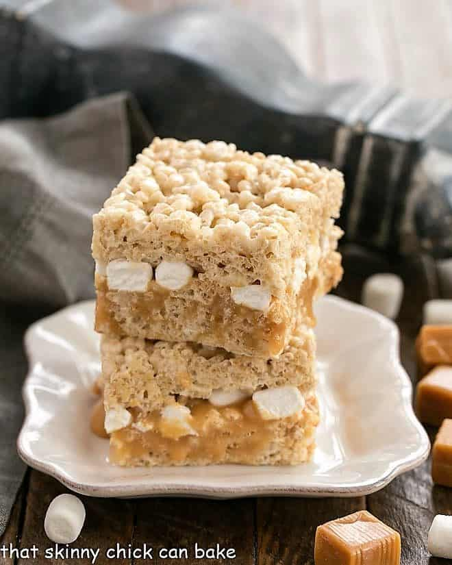 Caramel Stuffed Rice Krispie Treats on a square white plate
