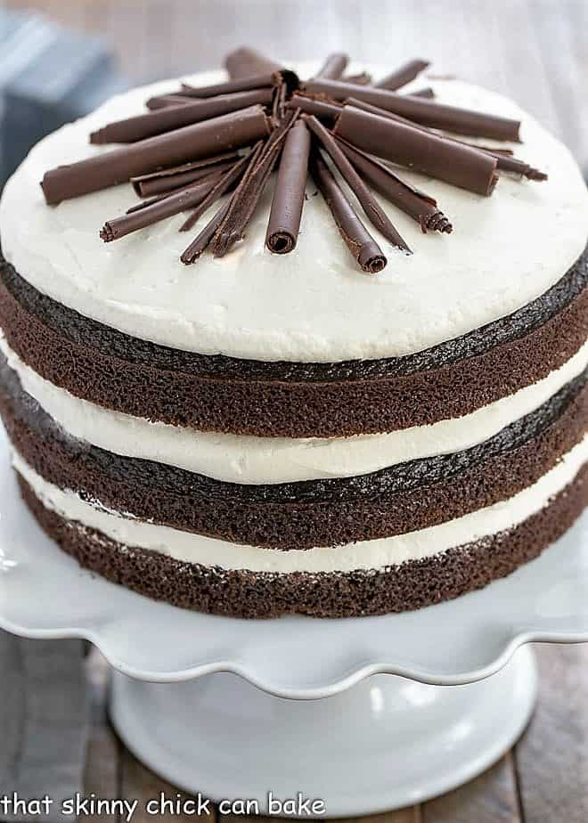 Triple Layer Chocolate Cake on a white ceramic cake stand