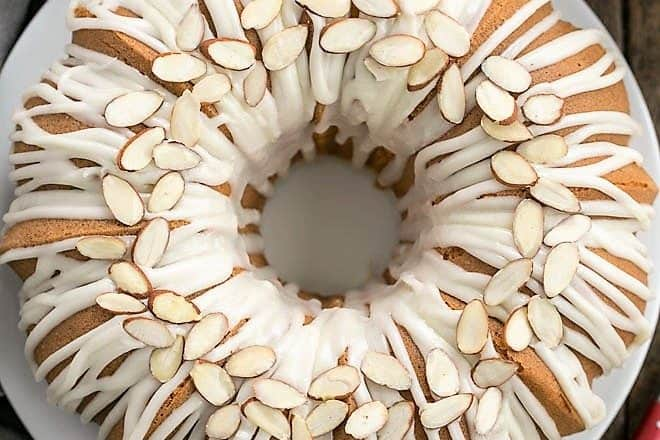 Easy Almond Bundt Cake with Amaretto Glaze on a white plate from above
