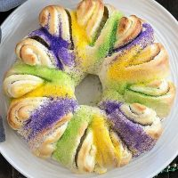 Easy King Cake with cream cheese filling on a round white serving dish viewed from above