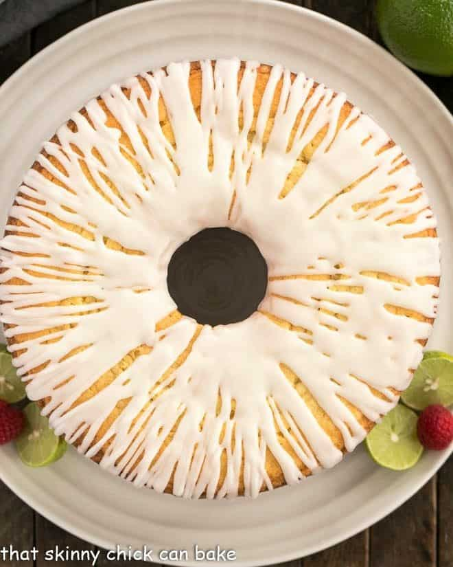 Overhead view of key lime pound cake on a white serving plate
