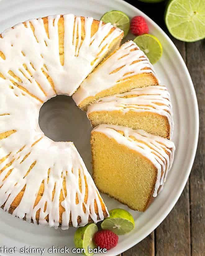A sliced key lime pound cake on a white serving plate
