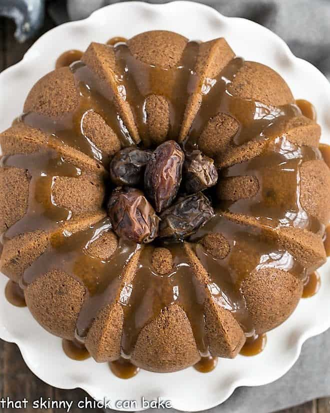 Caramel Topped Date Cake from above on a white cake stand