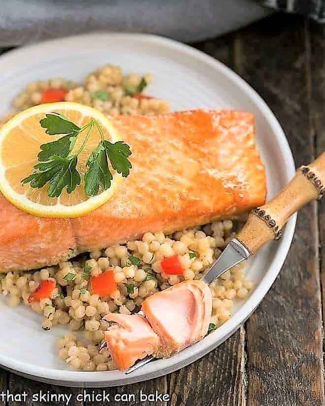 Easy Glazed Salmon on a white dinner plate with a fork holding a small piece of salmon
