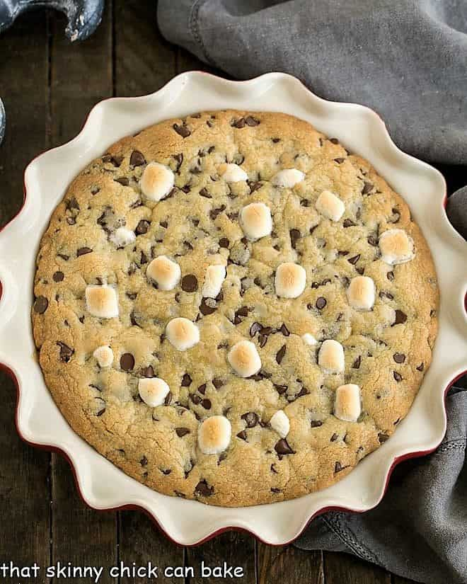 Gooey Chocolate Chip Pie in a red ceramic pie plate viewed from above