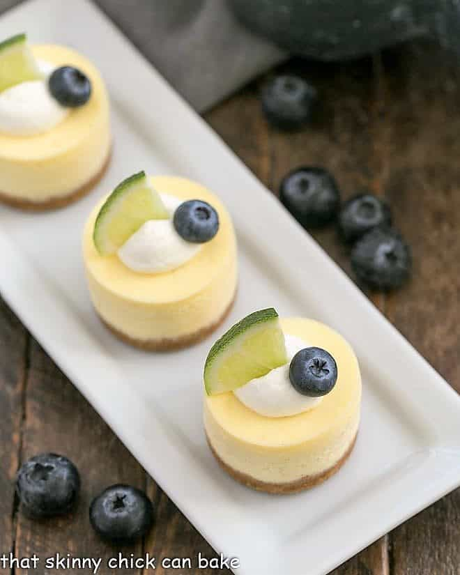 Mini Cheesecakes on a white rectangular tray viewed from above