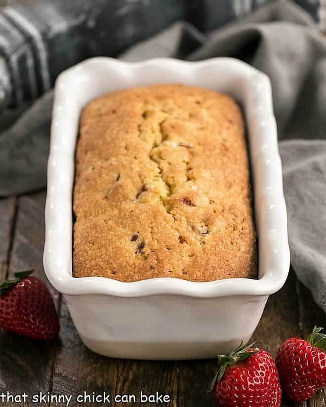 Fresh Strawberry Pound Cake in a white ceramic loaf pan