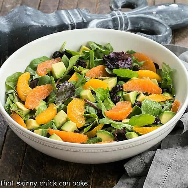 Cherry Orange Salad with Citrus Vinaigrette in a white ceramic serving bowl