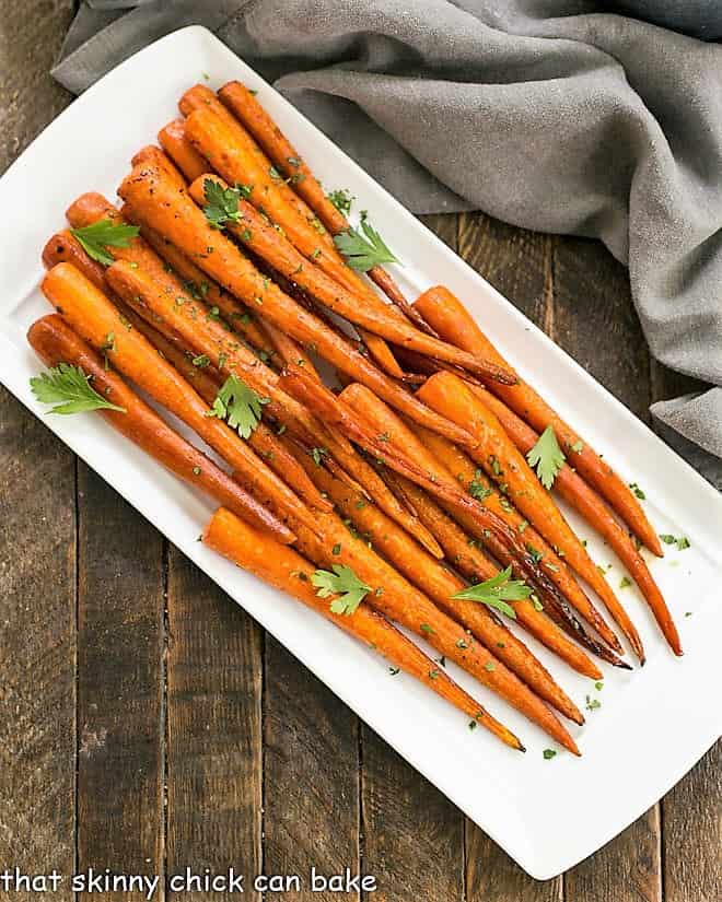 Overhead view of Honey Balsamic Roasted Carrots on a white platter