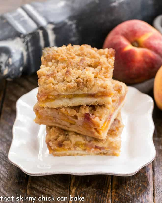 3 Fresh peach bars stacked on a square white plate