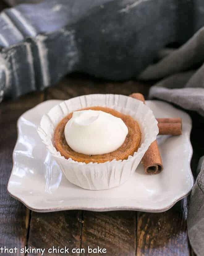 Pumpkin Pie Cupcake in a white paper wrapper on a square white plate