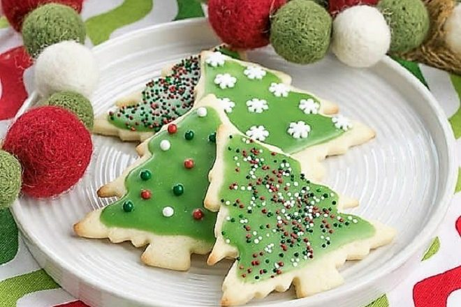 Frosted Holiday Sugar cookies on a round white plate