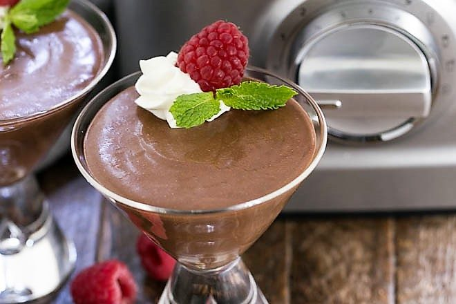 Blender Chocolate Mousse in a martini glass with whipped cream and raspberries
