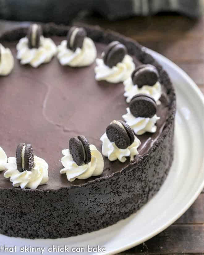 Partial view of a No Bake Oreo Cheesecake on a white serving plate