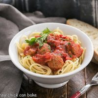 Pasta Sauce Recipe with Sausage in a white bowl with a red handled fork